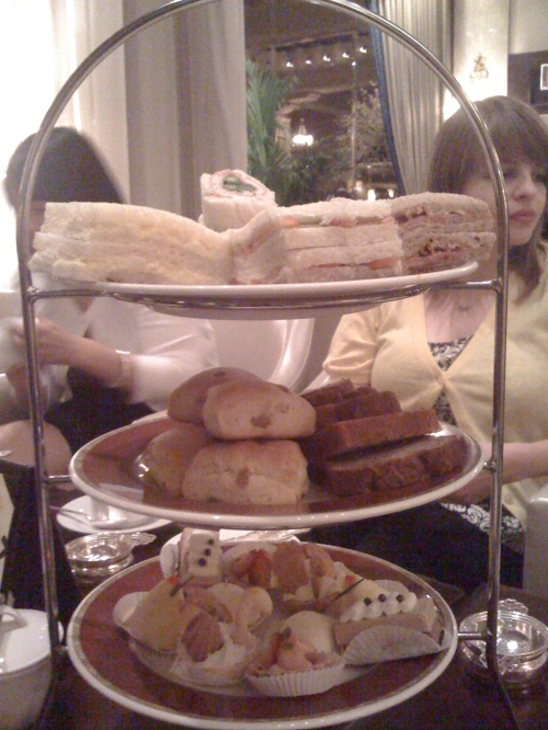 A delightful spread of pastries and sandwiches. Notice the lack of bothersome crusts on the sandwiches.