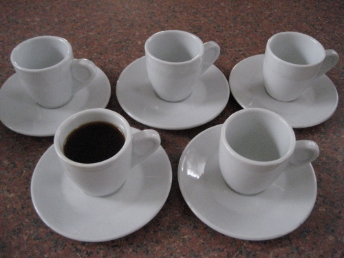 A set of espresso cups and saucers. Aren't these adorable? I was informed by their former owner that they are intended for Turkish coffee.