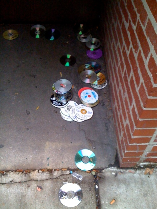 Someone's CD collection near the corner of Pearl on Chicago and Franklin